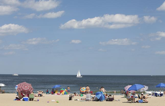 Beach with sailboat on the ocean