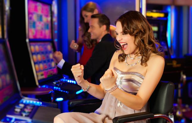 Girl winning at a slot machine