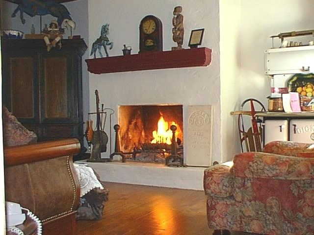 The Widow McCrea House invites you to relax by the fire and toast the day.