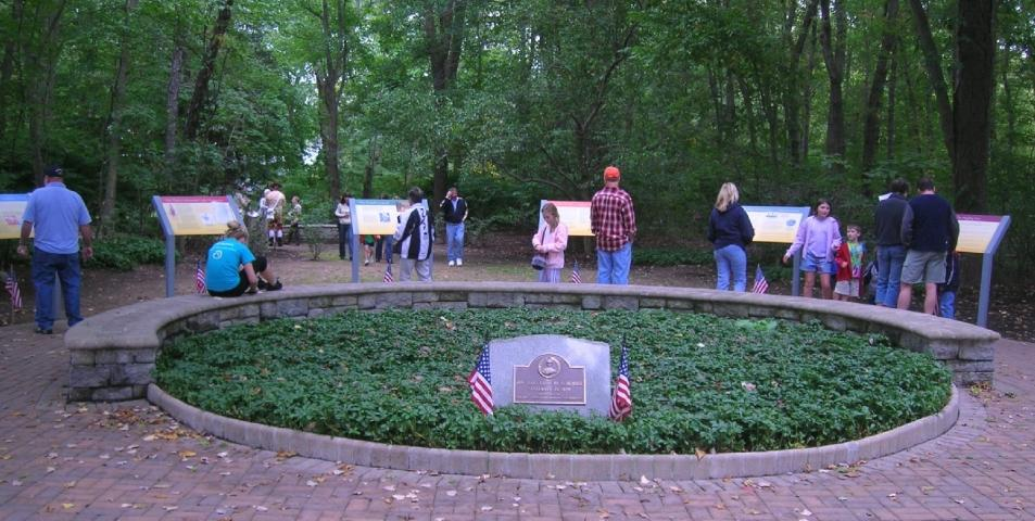 Baylor Massacre Site with visitors reading historic panels.