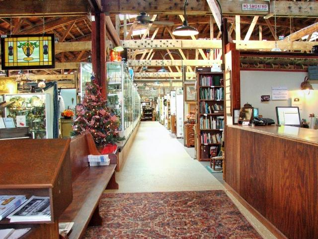 One of the brightly lit aisles full of collectables and antiques.