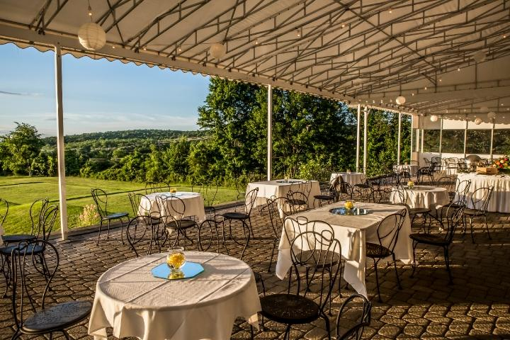 Covered outdoor terrace overlooking the first hole on the course