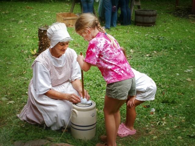 Guests can interact with historical interpreters and try their hand at chores from the 1800s, including butter churning!