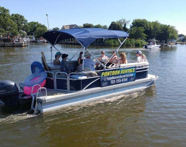 One of our 20 foot pontoons going out for a day on the bay. Our pontoons seat up to 10 people!