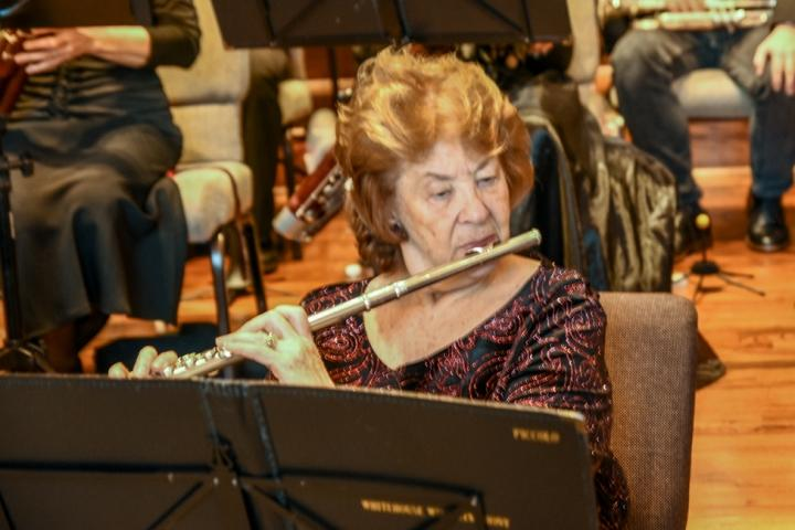 Flautist Jean Sinclair performs at a previous holiday concert by the Whitehouse Wind Symphony.